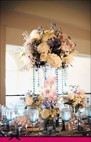 elegant tall wedding centerpiece with white roseswedwebtalks