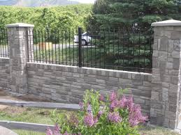 mounting wrought iron fence on top of concrete surface or wall