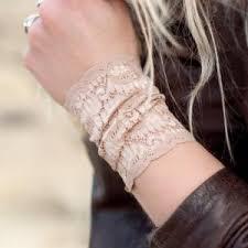 sideways cross charm string wrist cuff ecuatwitt