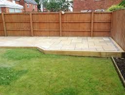 raised railway sleeper patio area with hexagonal shaped path