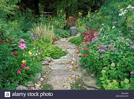 flowers in garden images path in garden with painted mexican ceramic vase and blooming