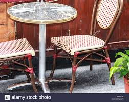 small patio table with two chairs small round table with two chairs in traditional outside café in