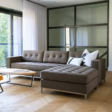 minimalist living room design with brown tufted sectional chaise