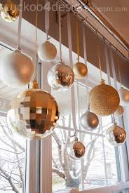 silver and gold glass ornaments hung from matching ribbon in