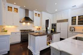 shaker kitchen island designs with white kitchen cabinets and wood floors white shaker