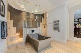 contemporary master bathroom with crown molding specialty tile