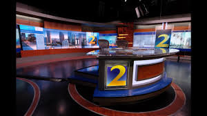 tv studio desk channel 2 action news unveils news and severe weather center 2