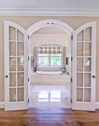 bathroom door designs master bathroom with arched bi fold doors transitional bathroom