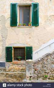 typical view of windows in a tuscan house in italy stock photo