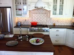 soapstone counters with a wood counter top soapstone werks soapstone is a great mix with wood butcher block a practical and clean look this kitchen has a verde minas soapstone counter surrounding a maple butcher