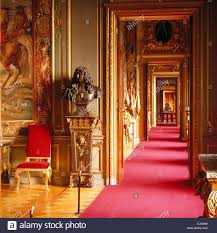 red carpet in grand rooms in blenheim palace birthplace of sir
