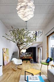 Living Room And Dining Room Together by The Floor Of This Living Room Becomes The Dining Table Contemporist