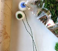 make felted wool eyeballs and display fun halloween craft the