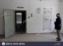 a visitor stands next to the entrance to the gas chamber stock