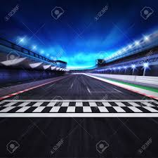race track finish line on the racetrack in motion blur with stadium and