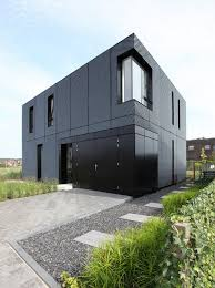 minimalist home with an eye catching expanding metal exterior