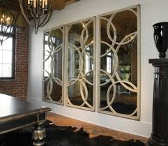 large mirror with cream wooden frame with circle shape placed on