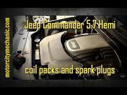 jeep commander 5 7 hemi coil pack and spark plug replacement youtube