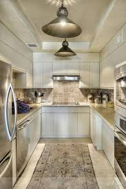 galley kitchen ideas with ceramic tiles and white cabinets and