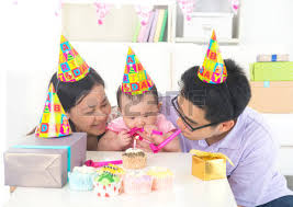 asian baby with family celebrating baby birthday party stock photo