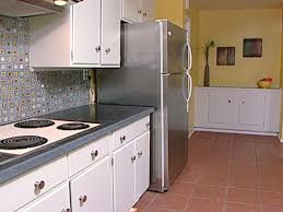 Small Kitchen Appliances Garage With Tiled Backsplash by Kitchenaid Stainless Steel Appliances White Wall Electric Stove