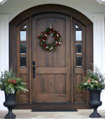 front door one day house arched entry with sidelights canopy