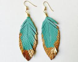 one side feather earring feather earrings leather feather jewelry dipped in gold