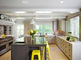 interior transitional style kitchen design with yellow barstools