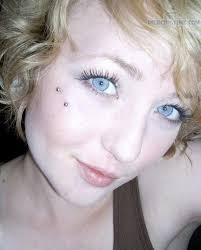 with butterfly piercing on