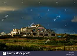 the beach house hotel at widemouth bay in cornwall stock photo