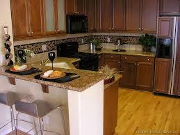 traditional dark wood golden kitchen cabinets 05 kitchen design