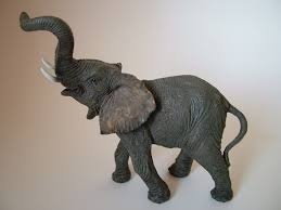 Sculpture For Home Decor by Decorating Playful Elephant Figurines For Home Accessories Ideas
