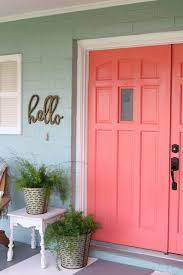 painted front door cheery coral painted front doors diy lolly jane
