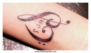 wrist tattoos of kids names 3