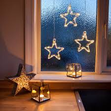 battery operated star lights battery operated warm white led acrylic star hanging window light by