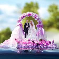 bridal decorations wedding miniature figurines of the and groom stock photo