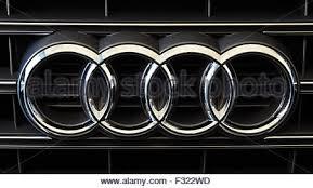 audi rings the audi four rings logo on a car dealership sign stock photo