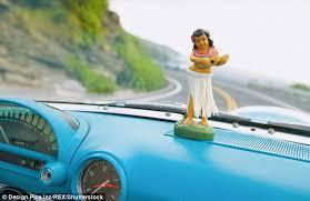 berates lyft driver for hawaiian bobblehead doll on