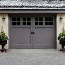 Cottage Style Garage Doors by Hillside House Traditional Garage And Shed Garage Ideas