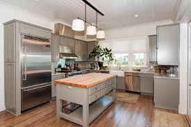 freestanding gray kitchen island with butcher block cottage