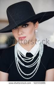 elegant woman black dress hat sitting stock photo 522331645