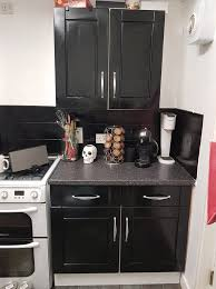 using high gloss paint on kitchen cabinets spends 43 transforming kitchen using black