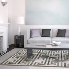 decorating cow skin rugs and white cowhide rug at living room