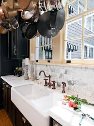 kitchen with marble backsplashes and black cabinets with
