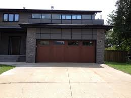 Costco Garage Doors Prices by Outdoor Brown Costco Garage Doors With Stone Wall Also Glass