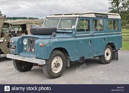 vintage land rover discovery land rover series ii long wheel base parked next to an old jeep