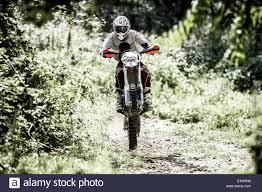 italian motocross bikes young man riding motocross bike in italian countryside stock photo