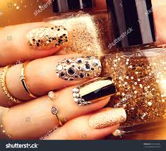 golden nail art manicure holiday style stock photo 367132055