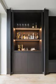 pivot sliding doors conceal the bar interior barn doors