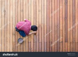 worker painting exterior wooden pool deck stock photo 456593695